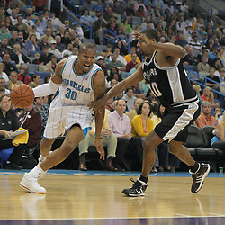 29 March 2009: New Orleans Hornets forward David West (30) drives past San Antonio Spurs center Kurt Thomas (40) during a NBA game between Southwestern Conference rivals the New Orleans Hornets and the San Antonio Spurs at the New Orleans Arena in New Orleans, Louisiana.