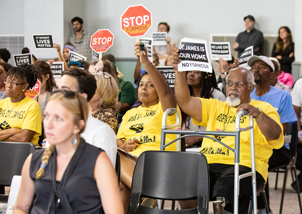 Sharon Lavigne, director of RISE St. James, nexdt to her brother, Milton Cayette, Jr., a St. James resident, at Louisiana's Department of Environmental Quality's  public hearing on whether to approve the 15 air permits for Taiwanese company Formosa Plastics in Vacherie, LA. on July 9, 2019.