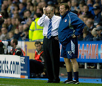 Photo: Daniel Hambury.<br />Reading v Arsenal. The Barclays Premiership. 22/10/2006.<br />Reading's manager Steve Coppell (L), scratches his head for answers, as one of his staff looks on.