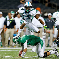 Oct 5, 2013; New Orleans, LA, USA; Tulane Green Wave cornerback Jordan Batiste (14) reacts after a tackle against North Texas Mean Green quarterback Derek Thompson (7) during the first half at Mercedes-Benz Superdome. Mandatory Credit: Derick E. Hingle-USA TODAY Sports