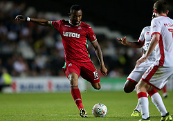 Swansea City's Jordan Ayew scores their fourth goal during the Carabao Cup, Second Round match at Stadium MK, Milton Keynes.