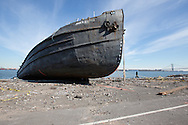 The John B. Caddell, a 700-ton tanker  washed up on the shore of Staten Island in New York by a storm surge caused by Hurricane Sandy