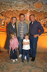 Left to right, actor JASON DONOVAN and his wife withe their children JEMMA & ZAC and Jason's father TERRY DONOVAN at a children's party in aid of the charity Over The Wall held at Fortnum & Mason, Piccadilly, London before a gala premiere of the new musical Mary Poppins at The Prince of Wales Theatre, Old Compton Street, London W1<br />