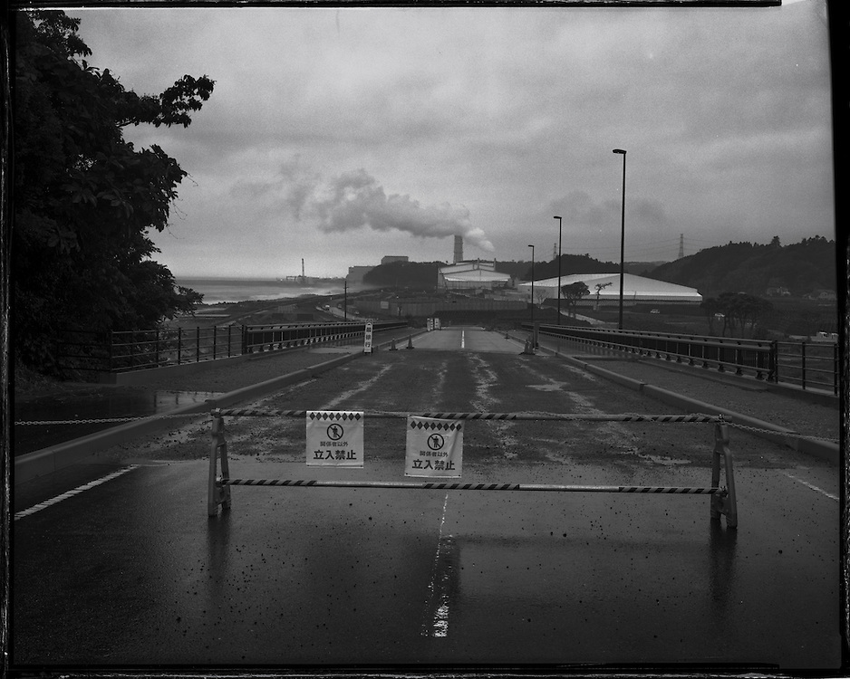 Tomioka, Fukushimaa site of Nuclear waste storage, sorting and processing  facility. Fukushima # 2  (Daini)  NPS in background