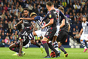 West Bromwich Albion midfielder (on loan from West Ham United) Grady Diangana (29) toys to get a shot away under pressure from Reading defender Andy Yiadom (17) during the EFL Sky Bet Championship match between West Bromwich Albion and Reading at The Hawthorns, West Bromwich, England on 21 August 2019.
