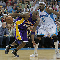 12 November 2008: Los Angeles Lakers guard Kobe Bryant (24) drives past New Orleans Hornets forward James Posey (41) during a 93-86 win by the Los Angeles Lakers over the New Orleans Hornets at at the New Orleans Arena in New Orleans, LA..