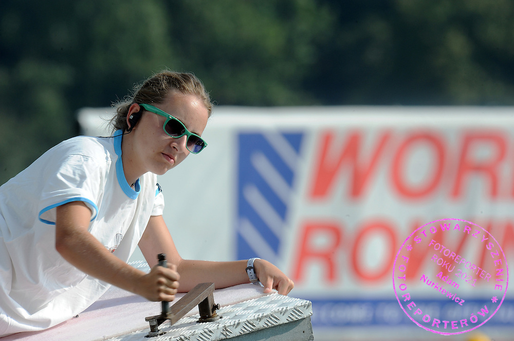 GIRL FIX PLATFORM BEFORE START THE RACE DURING DAY SIX OF REGATTA WORLD ROWING CHAMPIONSHIPS ON MALTA LAKE IN POZNAN, POLAND...POZNAN , POLAND , AUGUST 28, 2009..( PHOTO BY ADAM NURKIEWICZ / MEDIASPORT )..PICTURE ALSO AVAIBLE IN RAW OR TIFF FORMAT ON SPECIAL REQUEST.