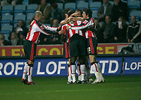 Southampton celebrate their controversial equaliser by ??