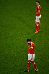CARDIFF, WALES - Monday, October 9, 2017: Wales' Ashley Williams and Wales' James Chester react during the 2018 FIFA World Cup Qualifying Group D match between Wales and Republic of Ireland at the Cardiff City Stadium. (Pic by Peter Powell/Propaganda)