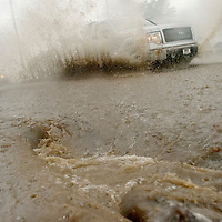 080214  Adron Gardner<br /> <br /> A truck splashes through deep water on Historic Highway 66 during heavy rains in downtown Gallup Saturday