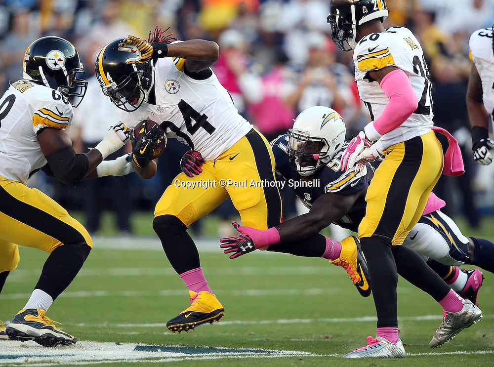 Pittsburgh Steelers running back DeAngelo Williams (34) gets tackled by diving San Diego Chargers outside linebacker Jeremiah Attaochu (97) on a first quarter run during the 2015 NFL week 5 regular season football game against the San Diego Chargers on Monday, Oct. 12, 2015 in San Diego. The Steelers won the game 24-20. (©Paul Anthony Spinelli)