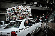 Protesters in a taxi bring a load of blankets to demonstrators that occupy day and night Tahrir Square in hope to force out Egyptian President Hosni Mubarak. 10 February 2011.