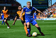 Jonathan Parr is tackled by Scott Golbourne during the Sky Bet Championship match between Wolverhampton Wanderers and Ipswich Town at Molineux, Wolverhampton, England on 18 April 2015. Photo by Alan Franklin.