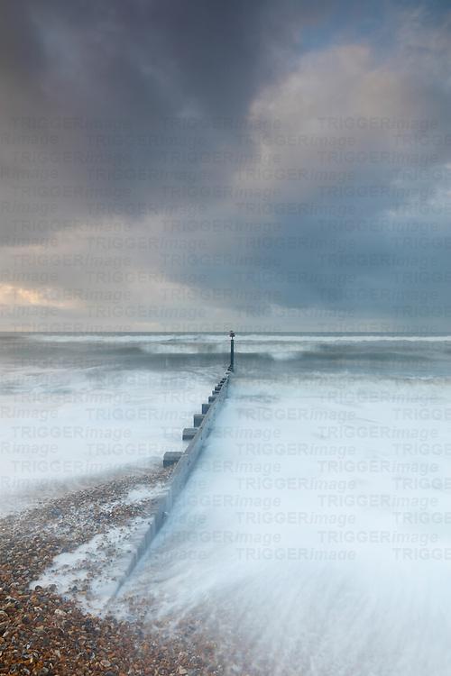 Winter sea view with groynes