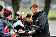 Simon Francis (2) of AFC Bournemouth signing his autograph for fans on arrival at the Vitality Stadium before the Premier League match between Bournemouth and Arsenal at the Vitality Stadium, Bournemouth, England on 14 January 2018. Photo by Graham Hunt.