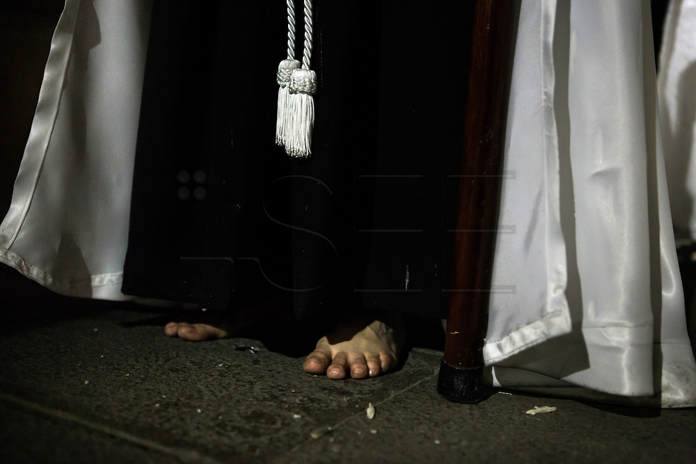 A barefoot penitent. General Procession of Good Friday considered<br /> Cultural Heritage of Matar&oacute; city (Barcelona, Spain) since 2013.  Easter 2015. Eva Parey/4SEE