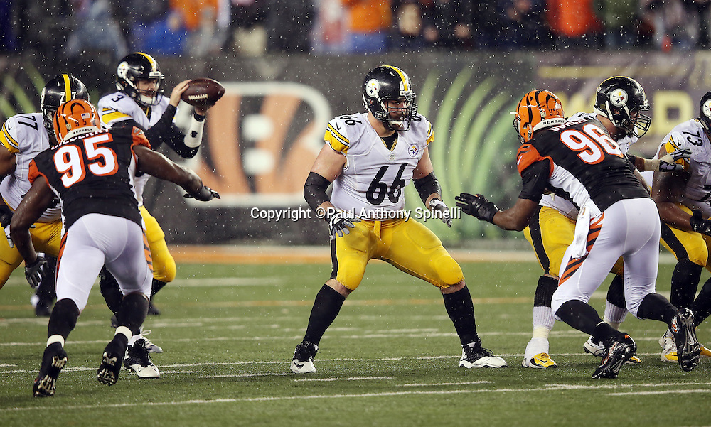 Pittsburgh Steelers guard David DeCastro (66) pass blocks while Cincinnati Bengals defensive end Wallace Gilberry (95) and Cincinnati Bengals defensive end Carlos Dunlap (96) rush the quarterback during the NFL AFC Wild Card playoff football game against the Cincinnati Bengals on Saturday, Jan. 9, 2016 in Cincinnati. The Steelers won the game 18-16. (©Paul Anthony Spinelli)