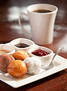 Homemade doughnuts with gourmet dipping sauces.