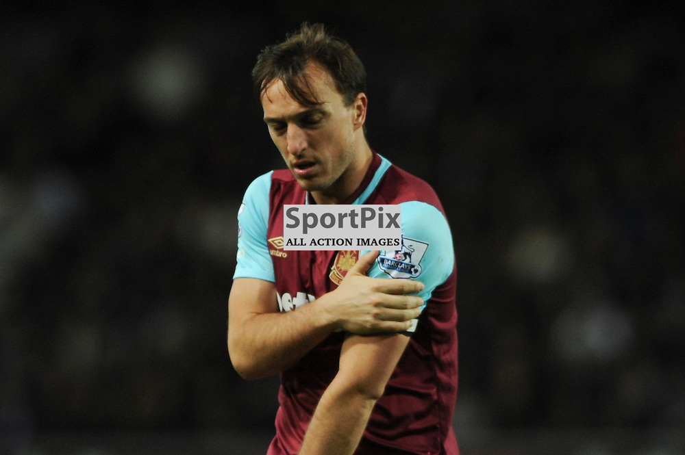 West Hams Mark Noble feels pain in his arm during the West Ham v Watford match in the Barclays Premier League on the 20th April 2016.