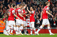 Arsenal players celebrate the opening goal during the Barclays Premier League match at the Emirates Stadium, London<br /> Picture by David Horn/Focus Images Ltd +44 7545 970036<br /> 28/04/2014