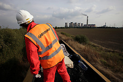 UK ENGLAND COTTAM 23SEP14 - Activists atop a coal waggon shovel coal into sacks during a protest against coal shipments to the UK.<br /> <br /> Over fifty Greenpeace UK activists stopped a freight train carrying 1,500 tonnes of coal to Cottam power station in Nottinghamshire, England.<br /> <br /> jre/Photo by Jiri Rezac / Greenpeace<br /> <br /> © Jiri Rezac 2014