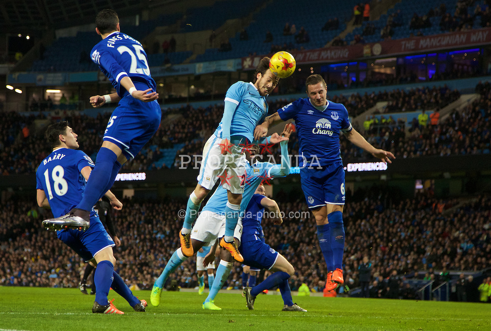 MANCHESTER, ENGLAND - Wednesday, January 27, 2016: Everton's captain Phil Jagielka in action against Manchester City's David Silva during the Football League Cup Semi-Final 2nd Leg match at the City of Manchester Stadium. (Pic by David Rawcliffe/Propaganda)