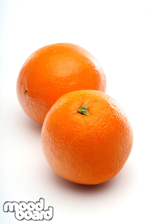 Oranges on white background - close-up