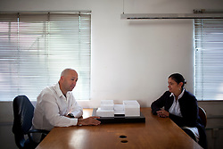 Jose Castillo  and Saidee Springall of Arquitectura 911Sc sit in their office in Mexico City.