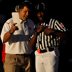 Sep 19, 2009; Piscataway, NJ, USA; Rutgers head coach Greg Schiano discusses a play with a referee during the first half of NCAA college football between Rutgers and Florida International at Rutgers Stadium.