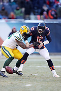 Green Bay Packers outside linebacker Julius Peppers (56) rushes and strip sacks Chicago Bears quarterback Matt Barkley (12) for a third quarter loss of 8 yards and a fumble recovery by Peppers at the Bears 17 yard line during the 2016 NFL week 15 regular season football game against the Chicago Bears on Sunday, Dec. 18, 2016 in Chicago. The Packers won the game 30-27. (©Paul Anthony Spinelli)