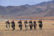 Kazakhs &amp; Golden eagles<br /> (Aquila chrysaetos)<br /> arriving to Annual eagle festival<br /> Western Mongolia