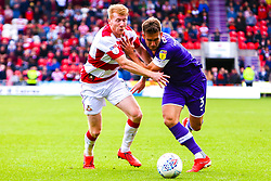 Brad Halliday of Doncaster Rovers puts pressure on Joe Mattock of Rotherham United - Mandatory by-line: Ryan Crockett/JMP - 07/09/2019 - FOOTBALL - The Keepmoat Stadium - Doncaster, England - Doncaster Rovers v Rotherham United - Sky Bet League One