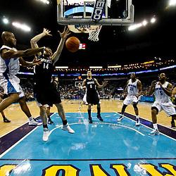 February 7, 2011; New Orleans, LA, USA; New Orleans Hornets point guard Jarrett Jack (2) passes the ball past Minnesota Timberwolves center Nikola Pekovic (14) to guard Marcus Thornton (5) during the second half at the New Orleans Arena. The Timberwolves defeated the Hornets 104-92.  Mandatory Credit: Derick E. Hingle