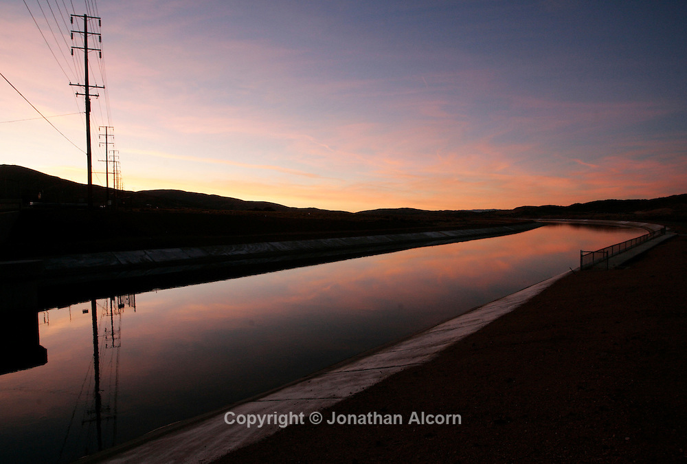 Nov 30, 2008 - Palmdale, California, USA - A portion of the California Aqueduct reflects the sky at dusk in Palmdale . The aqueduct brings much needed water from Northern California to the Southern California area. (Credit Image: © Jonathan Alcorn/ZUMA Press)