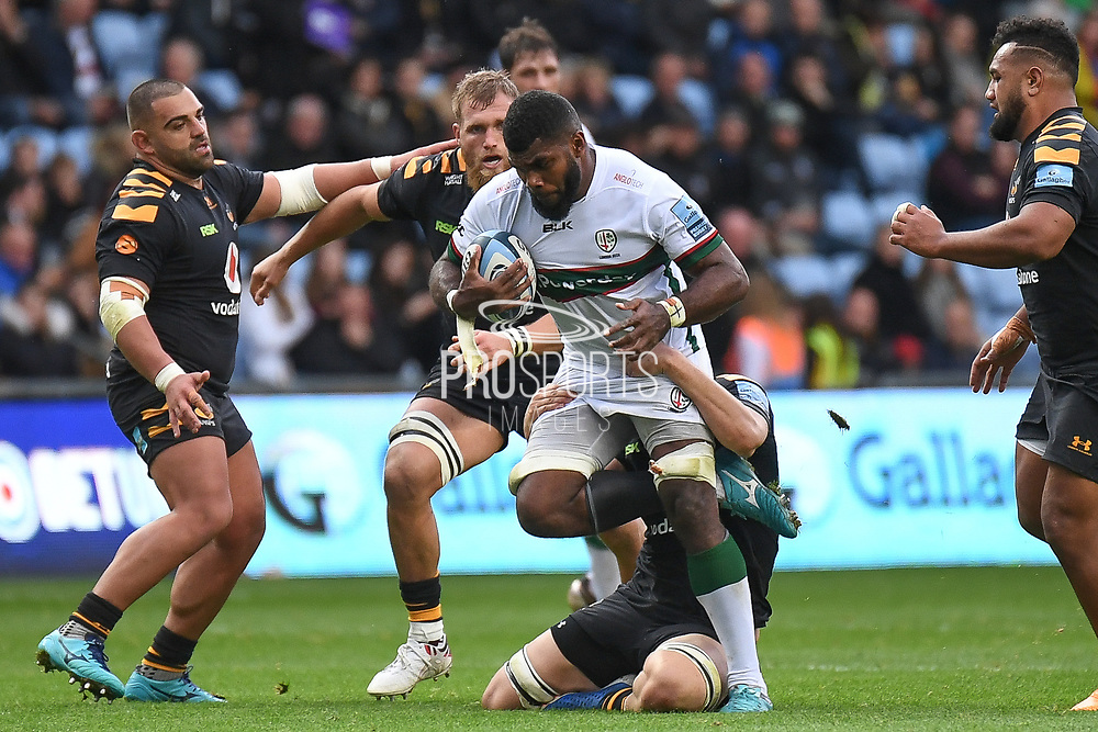 London Irish back row Albert Tuisue (8) breaks the tackle of Wasps back row Jack Willis (7) during the Gallagher Premiership Rugby match between Wasps and London Irish at the Ricoh Arena, Coventry, England on 20 October 2019.