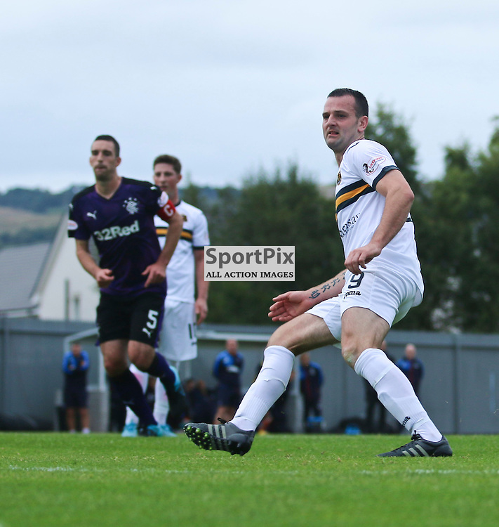 Garry Flemming slots home from the spot during the Dumbarton FC v Rangers FC Scottish Championship 19th September 2015 <br /> <br /> (c) Andy Scott | SportPix.org.uk