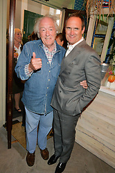 Left to right, MICHAEL GAMBON and AA GILL at the launch of the new collection from Limoland held at Anderson & Sheppard's Haberdashery, 17 Clifford Street,London on 16th June 2014.