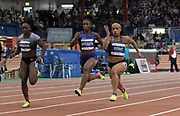 Feb 11, 2017; New York, NY, USA; Dezerea Bryant (USA), right, defeats Morolake Akinosun (USA), left, and Tianna Bartoletta (USA), center, to win the women's 60m in 7.12 during the 110th Millrose Games at The Armory.