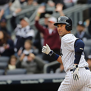 Derek Jeter, New York Yankees, watches his hit as he runs towards first base during the New York Yankees V Baltimore Orioles home opening day at Yankee Stadium, The Bronx, New York. 7th April 2014. Photo Tim Clayton