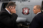 Anonymous guests look around a Sikorsky MH-60R helicopter at the Farnborough Airshow. ..The MH-60R is the U.S. Navy's newest and most advanced multi-mission helicopter, designed for anti-submarine and surface warfare (ASW/ASuW). Secondary missions include: Search and Rescue, anti-ship surveillance and targeting, communication relay and medevac/vertical replenishment. The Sikorsky-built helicipter with integrated avionics and mission systems by Lockheed Martin.