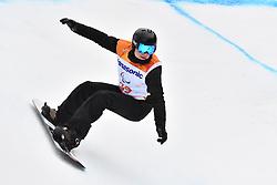 SUUR-HAMARI Matti FIN competing in ParaSnowboard, Snowboard Banked Slalom at  the PyeongChang2018 Winter Paralympic Games, South Korea.