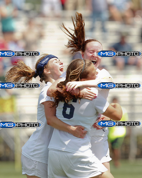 May 10, 2014; Huntsville, AL, USA; Oak Mountain girls celebrate after winning the 6A State Soccer Championship against Mountain Brook  at John Hunt Soccer Complex. Mandatory Credit: Marvin Gentry