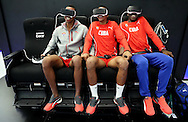 Jul 28, 2016; Rio de Janeiro, Brazil; Cuba volleyball players Javier Octavio Concepcion (left), Miguel Angel Lopez Castro (center) and Osniel Lazaro Mergarejo try the Samsung Galaxy virtual reality simulator at Athlete Village. Mandatory Credit: Peter Casey-USA TODAY Sports