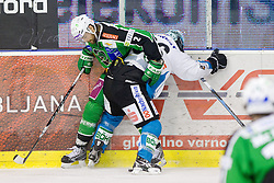 Brad Cole (HDD Tilia Olimpija, #2) vs Martin Mairitsch (EHC Liwest Linz, #86) during ice-hockey match between HDD Tilia Olimpija and EHC Liwest Black Wings Linz at fourth match in Semifinal  of EBEL league, on March 13, 2012 at Hala Tivoli, Ljubljana, Slovenia. (Photo By Matic Klansek Velej / Sportida)