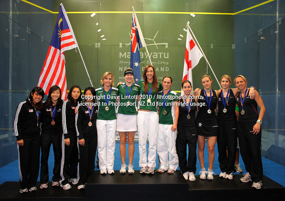 The podium placegetters, from left, Malaysia (third), Australia (champions) and England (runners up). Women's World Squash Teams final at International Pacific College Rec Centre, Palmerston North, New Zealand on Saturday, 4 December 2010. Photo: Dave Lintott / photosport.co.nz