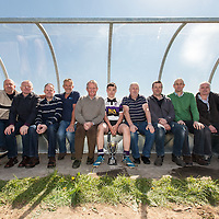 Employees of Moneypoint Power Station Mechanical Department, former collegues of the late Frank Nolan, with the U16 winning Kilrush Captain Eanna Cunningham and the Frank Nolan trophy. The Moneypoint employees constructed and donated the new dug outs for the Kilrush Rugby Grounds.