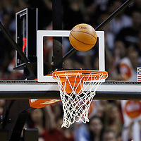 24 January 2012: a ball is seen on a basket during the Miami Heat 92-85 victory over the Cleveland Cavaliers at the AmericanAirlines Arena, Miami, Florida, USA.