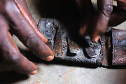 Benin, Natitingou April 22, 2005 - Scarificator and his material for the ceremony. Scarification is used as a form of initiation into adulthood, beauty and a sign of a village, tribe, and clan.