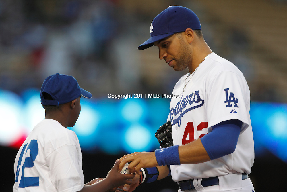 LOS ANGELES, CA - APRIL 15:  First baseman James Loney #7 of the Los Angeles Dodgers signs an autograph before the game between the St. Louis Cardinals and the Los Angeles Dodgers on Friday April 15, 2011 at Dodger Stadium in Los Angeles, California. (Photo by Paul Spinelli/MLB Photos via Getty Images) *** Local Caption *** James Loney