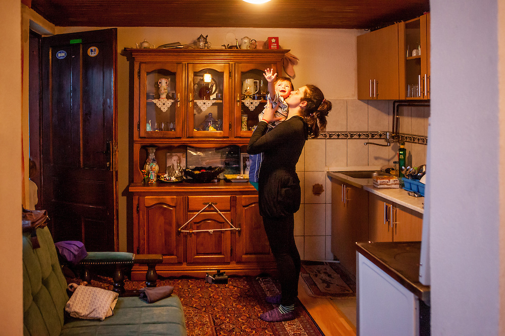 The family of former refugee Elvis Causevic. His wife Irma with their son Aldin (1 1/2) in the kitchen at the  families house in Hadžići. The family settled here after the war ended in Bosnia. Hadžići is a town and a municipality located about 20 km south west of Sarajevo city but within the Sarajevo Canton of Bosnia and Herzegovina. According to the census of 2013, Hadžići municipality has a population of 23,891 residents.